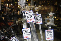 18-05-2006 - Window display in the shop called Victor Morris in Glasgow city centre. The shop sells various sporting goods including hunting knives and replica swords, pistols, and rifles, as well as musical equip... © Gerry McCann