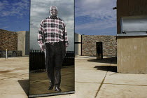 20-04-2005 - Mirrored artworks depicting the country's ethnic diversity, on the roof of the Apartheid Museum in Johannesburg, South Africa. © Gerry McCann