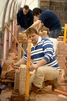 30-07-2004 - Students at Mancat college, Manchester, learn building and bricklaying skills © Paul Herrmann