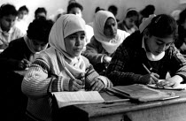 01-07-1993 - Palestinian refugee children studying at an UNRWA school, Beach refugee camp, West Bank. 1993 © Howard Davies