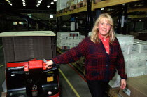 16-12-1999 - Women worker moving cardboard on a trolley, production line at OUP automated print distribution centre Corby © John Harris