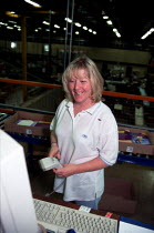 16-12-1999 - Women worker with bar code reader and computer on production line at OUP automated print distribution centre Corby © John Harris