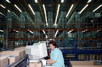 16-12-1999 - Women worker using computer on production line at OUP automated print distribution centre Corby © John Harris