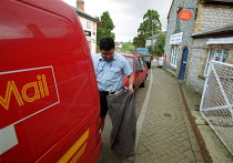 18-05-2000 - Postal worker collecting post from rural village post office. © John Harris