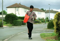 16-08-2000 - Paperboy on his delivery round with his bag of newspapers. © John Harris