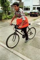 16-08-2000 - Paperboy on his delivery round with his bag of newspapers and bicycle. © John Harris