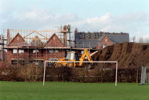 07-03-2002 - New houses being built on School playing fields. The School has sold off the land to pay for the construction of new school buildings. © John Harris