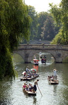 10-08-2003 - Students and tourists punting along The Backs, by Clare Bridge, Clare College, Cambridge. Punt chauffeurs push them along. © John Harris