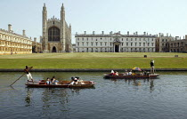 10-08-2003 - Students and tourists punting along The Backs, by King's College Chapel and University, Cambridge. Punt chauffeurs punt them along. © John Harris