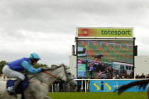 02-09-2006 - Horse and jockey pass the totesport display screen. Steeplechase racing at Stratford on Avon racecourse. © John Harris