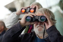 02-09-2006 - Punters watching the race through binoculars. Steeplechase racing at Stratford on Avon racecourse. © John Harris