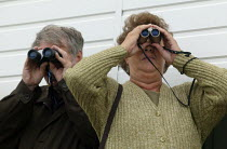 02-09-2006 - Racegoers watching the race through binoculars. Steeplechase racing at Stratford on Avon racecourse. © John Harris