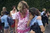 23-07-2010 - Adult comforting a pupil. Emotional scenes in the playground on the last day of term for those leaving at the end of their primary school education. © John Harris