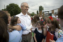 23-07-2010 - The Headteacher gets a big hug. Emotional scenes in the playground on the last day of term for those leaving at the end of their primary school education. St Gregory's Catholic Primary School, Stratfo... © John Harris