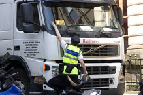27-07-2012 - Civil Enforcement Officer on patrol, issuing a Penalty charge notice, sticking it to the windscreen of an illegally parked lorry, Birmingham. © John Harris