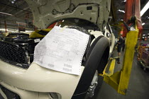 24-10-2012 - Bespoke assembly to customer order print out. BMW Group Mini production line, Cowley, Oxford © John Harris