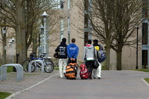 21-04-2013 - Cricket players walking with their kit bags back to their student accommodation after a Sunday cricket game, Warwick University © John Harris