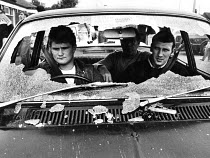 12-08-1984 - Striking miners after police smashed their windscreen, 1984. NUM members sitting in their car, on strike during the Miners' Strike were attacked at night by baton wielding riot police at a police road... © John Harris