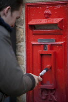 20-10-2013 - A man painting a disused rural Postbox, Enstone, Oxfordshire © John Harris