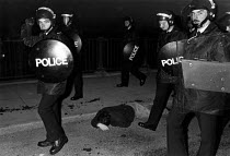 02-10-1984 - Riot police baton charge striking miners mass picket 1984 , Thurcroft pit village, South Yorkshire. Injured picket on the floor © John Harris