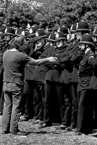 03-06-1984 - Picket inspecting police lines Battle of Orgreave 1984 and arguing with an officer. Orgreave Coking works, South Yorkshire. © John Harris