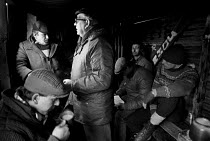 11-02-1985 - Picket hut, Fryston colliery, miners strike 1985 Yorkshire. Pickets discussing the year long strike and drinking tea © John Harris
