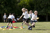 02-07-2014 - Commando Joe; wake and shake and initiative to improve attendance and punctuality by working with an ex member of the armed forces, playing field, St Richard's C E First School, Evesham © John Harris