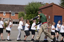 02-07-2014 - Commando Joe, a crocodile comes down the line; wake and shake and initiative to improve attendance and punctuality by working with an ex member of the armed forces, lining up in the playing field, St... © John Harris