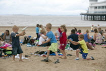 04-07-2014 - Playing pirates, St Richards C E First School trip to the seaside, Weston Super Mare, Somerset © John Harris