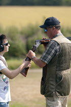 23-07-2014 - Clay Pigeon Shooting lesson from champion shot John Timmis for a novice at a Club in Warwickshire © John Harris