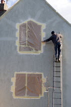 12-05-2014 - Builder redecorating the exterior of a house, Kineton, Warwickshire © John Harris