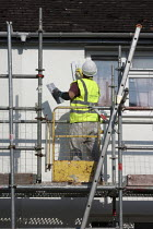 11-06-2015 - British Gas workers insulating houses to reduce enegy consumption, Evesham © John Harris