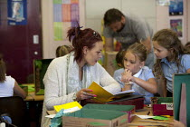 06-07-2015 - Parent going through exercise books. Open Day for parents of pupils at primary school, St Richards First School, Evesham, Worcestershire © John Harris