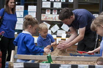 06-07-2015 - Playing in the sandbox. Open Day for parents of pupils at primary school, St Richards First School, Evesham, Worcestershire © John Harris