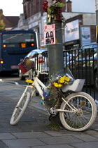 29-09-2015 - A Ghost Bike, bicycle painted white as a roadside memorial where a cyclist was run over and killed by a vehicle, Birmingham. Also intended to remind drivers of road safety. © John Harris