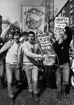 14-04-1984 - Young striking miners from Bolsover protest, Nottingham 1984. Carrying a coffin: Don't let our NUM die. © John Harris
