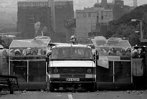18-06-1984 - Battle of Orgreave 1984. Riot Police, winged riot van confront a mass picket striking miners, Orgreave coking works during the year long dispute Sheffield © John Harris