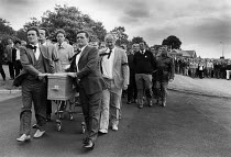 22-06-1984 - Funeral of Joe Green, 1984 Striking miners walk with the coffin at the funeral of Joe Green, the second miner to have been killed on a picket line. Yorkshire coalfield. Joe Green was crushed to death... © John Harris