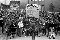 04-03-1985 - The bitter end, Miners Strike 1985. Miners Wives support group leading the return to work as the strike ends. Rossington pit village © John Harris