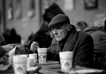 23-12-1988 - Homeless man in temporary shelter provided by charitable donation to Crisis at Christmas which provide accommodation and food of the festive winter period © John Harris