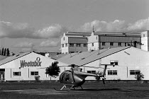29-09-1988 - Managing Director's helicopter in which he commutes to work outside the Weetabix factory Kettering Many of the employees are women who work part time and who are low paid © John Harris
