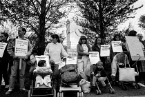 10-10-1989 - Local community including parents and their children in pushchairs protesting outside the Rechem waste incineration plant Pontypool where worry over the level of PCB deposits in the area has led to ca... © John Harris