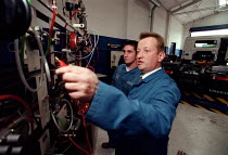 10-10-1997 - Lecturer training an NVQ student in heavy vehicle maintenance, repair, servicing and testing. Further Education College © John Harris