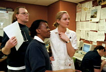 13-01-1999 - Accident and Emergency team looking a schedule. Hospital Birmingham © John Harris