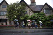 10-09-2011 - Tourists visiting historic Stratford on Avon in the rain walk past Halls Croft, the mansion was the residence of Shakespeares daughter, Susanna, and her physician husband, John Hall. A Shakespeare Tru... © John Harris