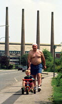 17-06-2000 - Family walk past Corus Steel Mill, Rotherham, UK © Jess Hurd
