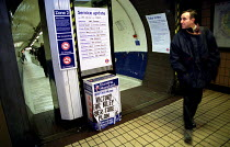 05-02-2001 - Commuter reads London Underground service update on tube delays. ALSEF and RMT day of action over safety concerns about PPP and privatisation. © Jess Hurd
