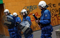 01-06-2003 - Riot police patrol a shopping area during anti G8 Summit protests in Geneva, Switzerland. © Jess Hurd