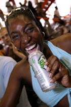 19-07-2003 - Woman enjoys a drink at the Workers Beer Comapny Stand, Millennium Dome Respect Festival. © Jess Hurd