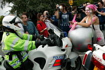 10-09-2003 - Protesters disrupt the police operation at Defence Systems and Equipment International Arms Fair, Excel Centre, London. © Jess Hurd